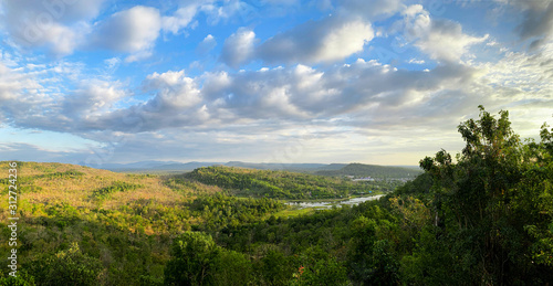 Fototapeta Landscape view of forest, mountain, and cloudy sky at border of Thailand and Lao obraz