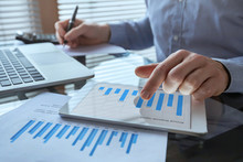 Businessman Working With Financial Report Charts, Business Analytics And KPI, Finance Concept