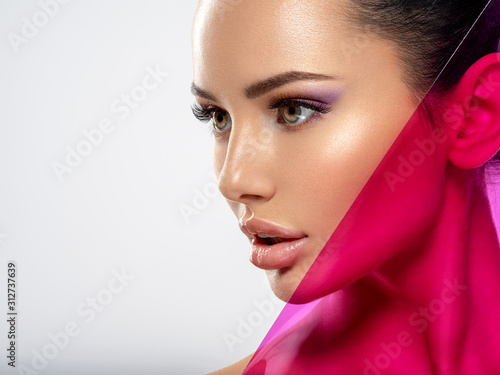 Photographie Beautiful white girl with bright eye-makeup