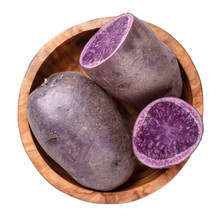 Raw Purple Potatoes In Wooden Bowl Isolated On White Background. Top View.