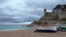 Tossa De Mar, Sand Beach Beneath The Historical Old Town Walls On Costa Brava Mediterranean Coast, Catalonia, Spain