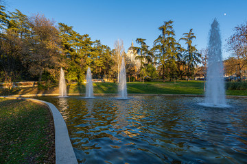 Atena's Park fountains with the Almudena Cathedral on the backgroung in Madrid, Spain.