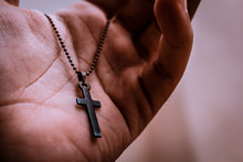 Hand With Rosary Isolated On W...