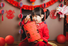 Chinese Baby Girl  With Traditional Dressing Up Celebrate Chinese New Year