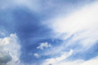canvas print picture - Blue sky and fluffy clouds. Beautiful cloudscape background. Sunlight on the clouds.