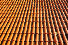 Brightly Lit Red Tiles Roof For Background