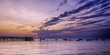 Sunrise Over The Ocean With Silhouettes Of A Wooden Pier. Noirmoutier Island, France.