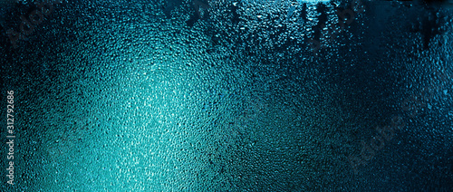 Blue color water drops on wet glass. Abstract texture background. Poster Mural XXL