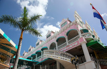 Pink And Turquoise Buildings O...