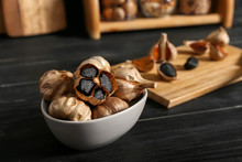 Bowl With Black Garlic On Kitchen Table