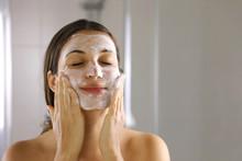 Skincare Woman Washing Face  F...
