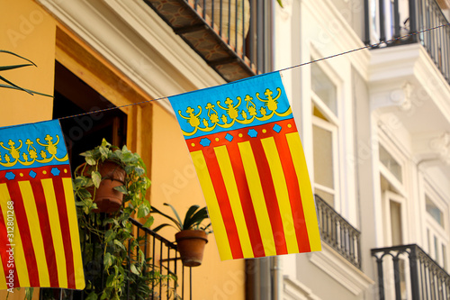 Red yellow and blue striped Valencia Flag on a bright spring day