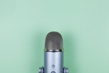 Closeup Of Professional Microphone On Mint Background. Podcast Studio Concept. Electronic Mic