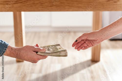 Cuadros en Lienzo  Giving a bribe under table