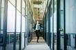 Caucasian businessman running on office hallway