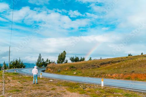 Young tourist traveler appreciating rainbows in Cajamarca Peru Canvas Print