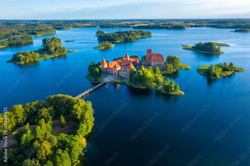Fototapeta Blue lakes around old castle Trakai in Lithuania aerial view. View from above to Trakai castle