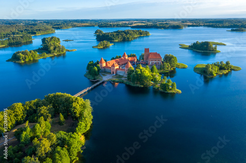 Blue lakes around old castle Trakai in Lithuania aerial view. View from above to Trakai castle