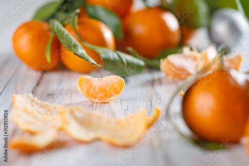Fototapeta Close-up view of one slice of tangerine