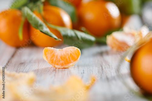 Obraz na plátně Close-up view of one slice of tangerine