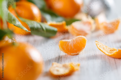 Fotografie, Obraz Close-up view of one slice of tangerine