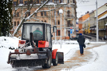 Tractor Cleaning Sidewalk From...