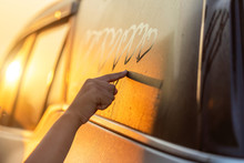 Asian Little Girl Writing Or Drawing Heart Symbol On Wet Mirror Of Her Father SUV Car In Morning