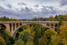 Aerial View Of The Adolphe Or New Bridge In The UNESCO World Heritage Site Old Town Of The City Of Luxembourg, In Fall