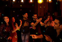 Group Of Friends Dancing And E...