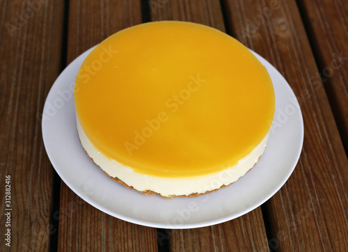 Gluten-free vegan orange and mango cheesecake created using vegan agar agar powder Wallpaper Mural