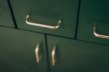 Retro Kitchen Of Emerald Color, Drawer With Metal Handles. Kitchen Trends.  The Main Subject Is Out Of Focus, Film And Grain Photo