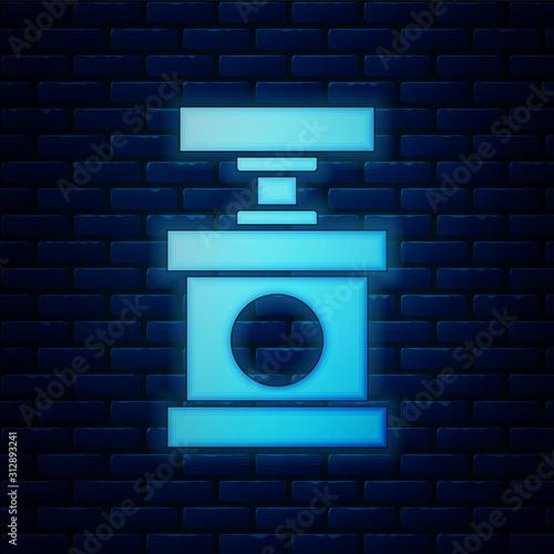 Fotografia  Glowing neon Handle detonator for dynamite icon isolated on brick wall background