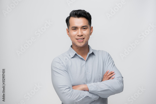 Fototapeta Smart asian business man on white obraz