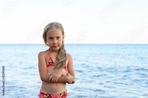 Valokuvatapetti six years old little girl having fun at summer vacation in sea