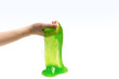 canvas print picture - Green slime toy in woman hand isolated on white.