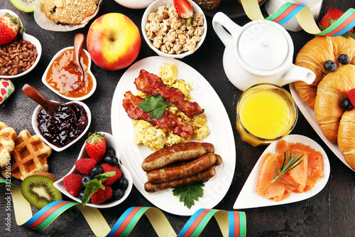 Breakfast served with coffee, orange juice, croissants, cereals and fruits. Balanced diet. Continental breakfast on carnival or new year © beats_