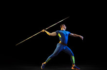 Male Athlete Practices In Throwing Javelin On Black Background In Neon Light. Professional Sportsman Training In Action, Motion. Concept Of Healthy Lifestyle, Movement, Activity, Competition