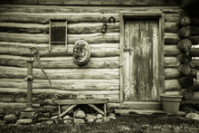 Simple Country Living. Exterior Wall Of A Historical Log Cabin In Midwest America. This Is A Historical Public Display In Maysville, Michigan. It Is Not A A Private Property Or Residence.