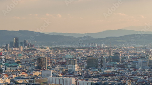 Photo Aerial panoramic view of Vienna city with skyscrapers, historic buildings and a riverside promenade timelapse in Austria