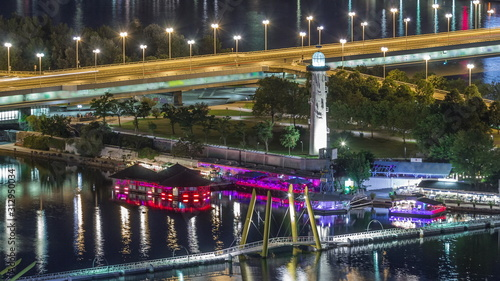 Aerial panoramic view over Vienna city with skyscrapers, historic buildings and a riverside promenade night timelapse in Austria Wallpaper Mural