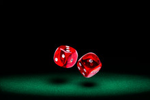 Red Dice Rolling On Green Felt