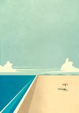 Woman Sunbathing Under Umbrella On Remote Ocean Beach