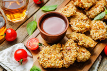Almond Crusted Chicken Tenders With Ketchup On A Wood Background