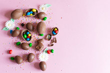 Chocolate Easter Eggs On Pastel Pink Colored Background Flat Lay. Copy Space.