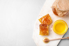 Tasty Honey On Light Grey Table, Top View. Space For Text