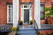 canvas print picture - A view of a historic brownstone building in an iconic neighborhood of Manhattan, New York City