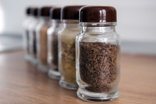 Row Of Spice Jars Containing V...