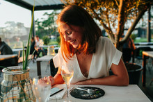 Woman In Restaurant Using Cell...