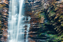 Close Up Of White Veil Of Water Flowing Down Over Rocky Wall In Brazil