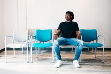 Gen Z Boy Sitting In Doctors W...